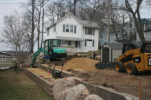 Installing a Parking Pad with Retaining Wall