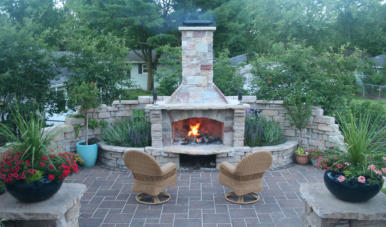 Custom fireplace with walls and patio